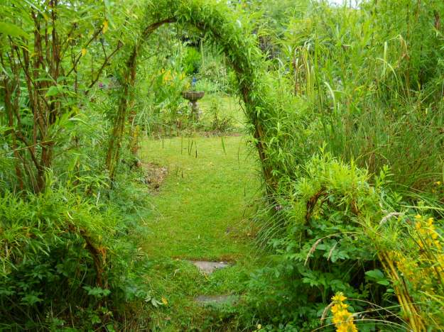 willow arch and spaghnum moss on the lawn at Bealtaine Cottage