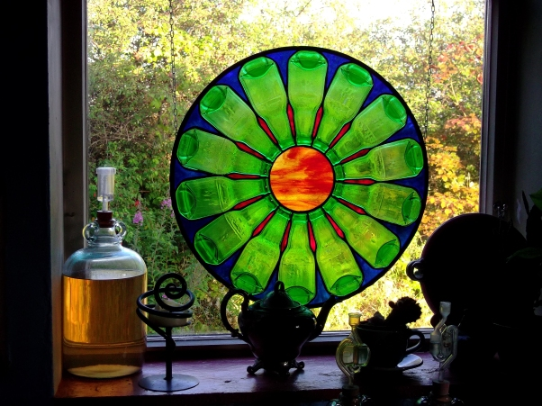 stained glass wheel of life at bealtaine Cottage permaculture gardens