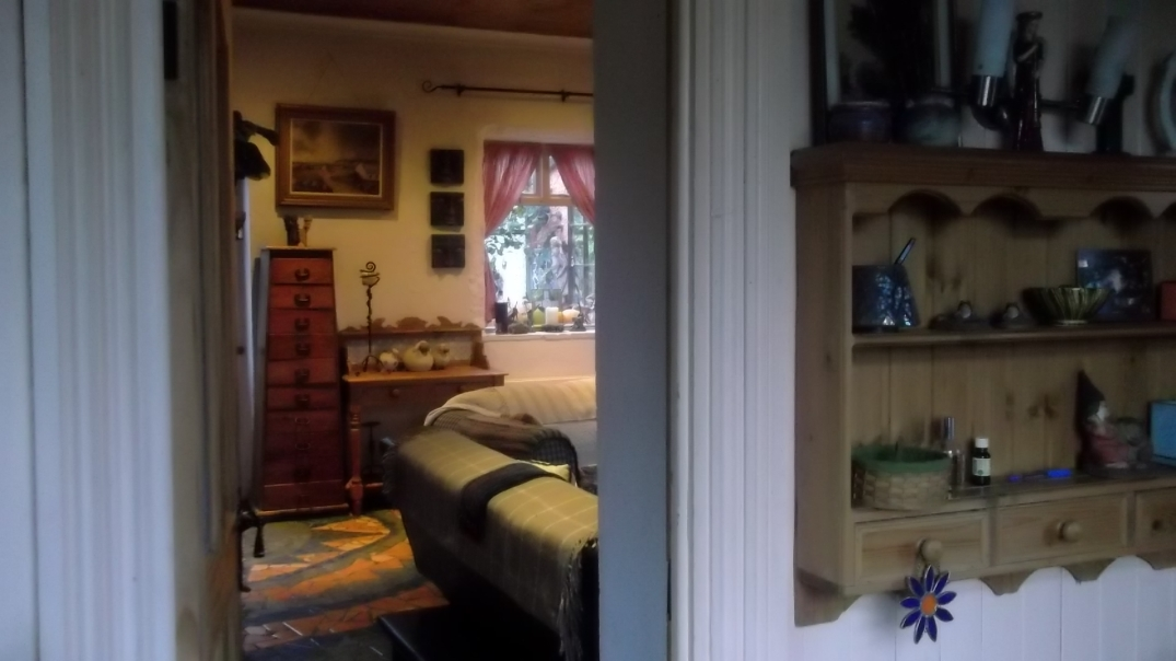 Porch and sitting room at Bealtaine Cottage
