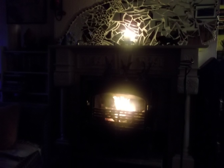 Wood burning stove at Bealtaine Cottage