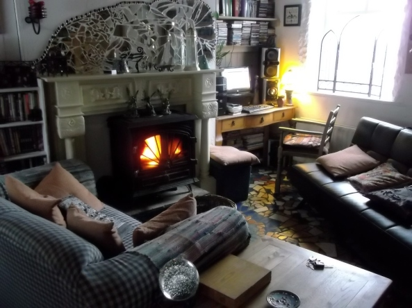 Multifuel stove in the sitting room at Bealtaine Cottage