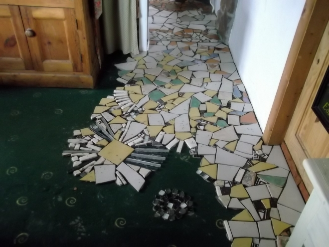 Mosaic tiling kitchen floor at Bealtaine Cottage