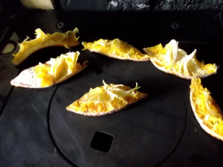 Orange waste infusing the air with beautiful aroma on top of the stove