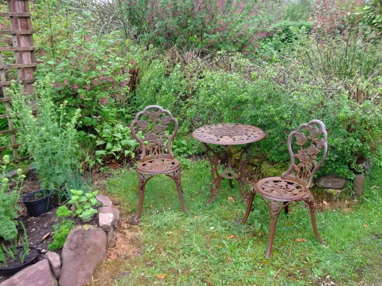 Metal table and chairs at Bealtaine Cottage