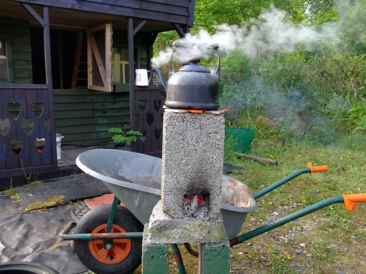 rocket stove in the permaculture garden
