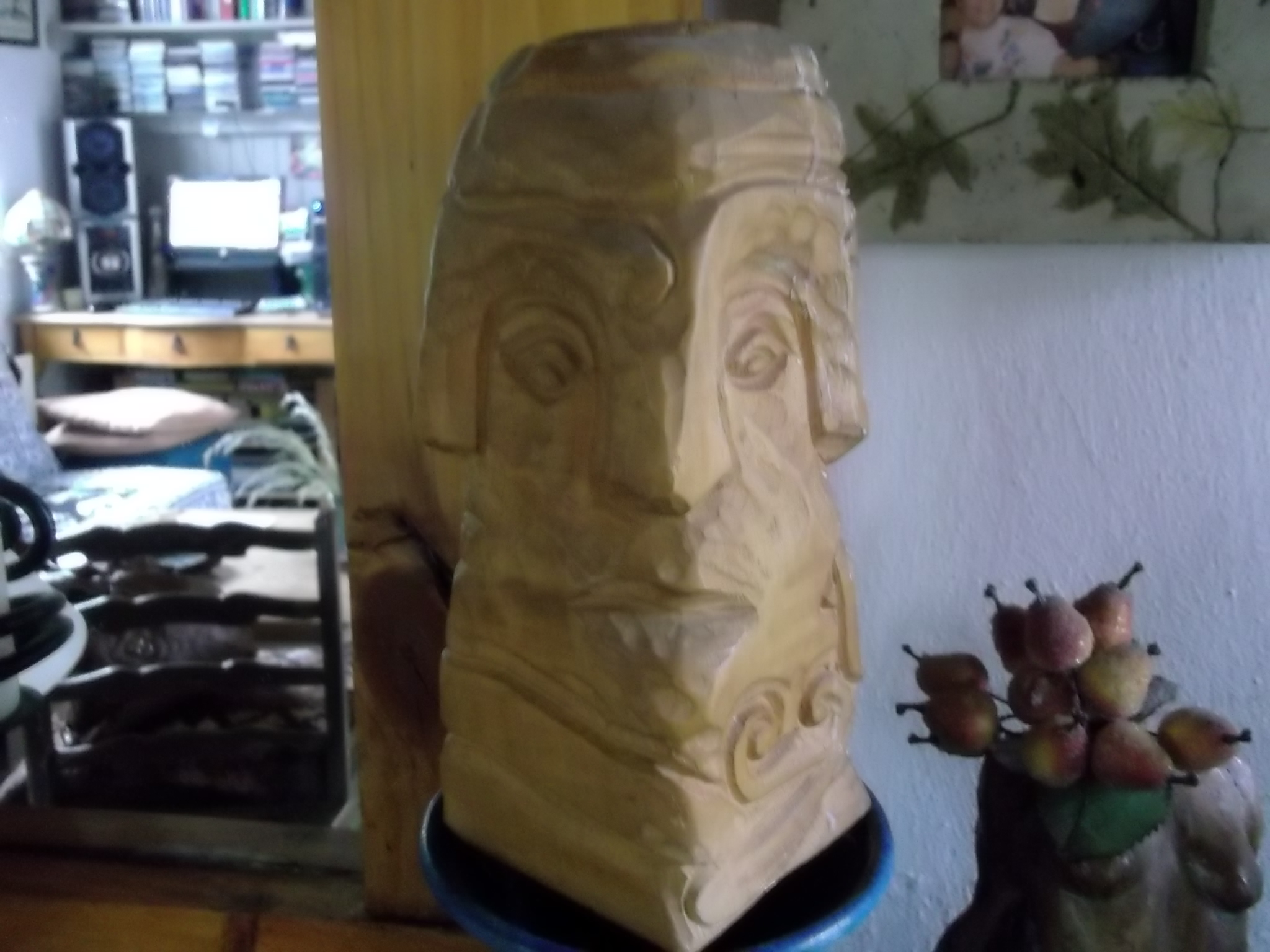 The carved head of Lugh looks in all directions