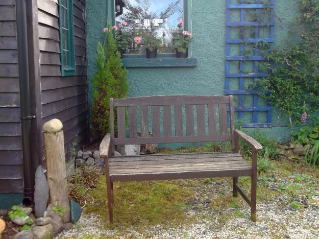Bench by entrance porch