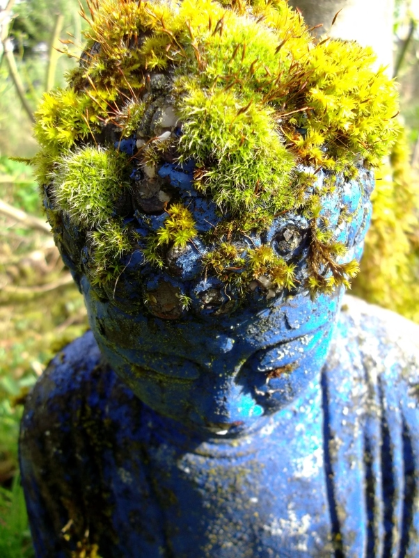 Buddha wears a crown of moss in the Bog Garden